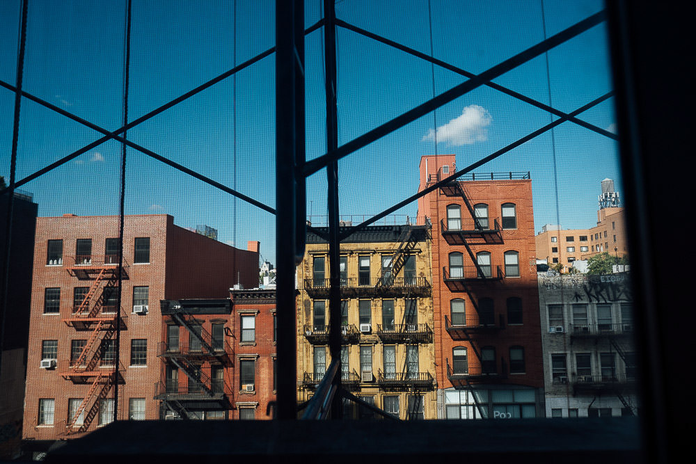 VIEW OF NEW YORK SKYLINE THROUGH WINDOWS AND SCAFFOLDING