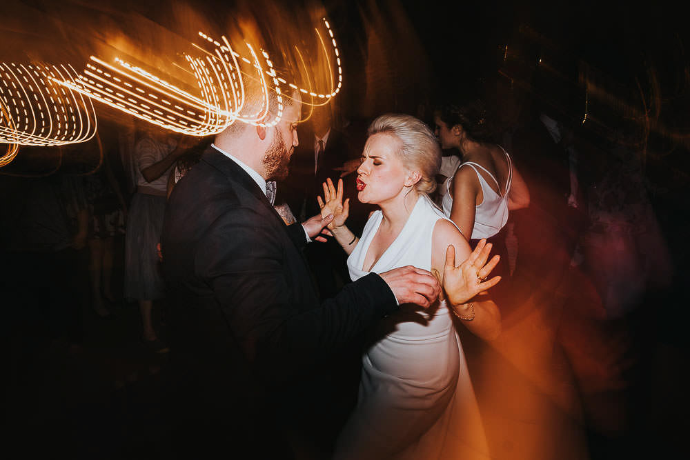 KENT WEDDING PHOTOGRAPHER BRIDE AND GROOM DANCING SHUTTER LAG LIGHTS