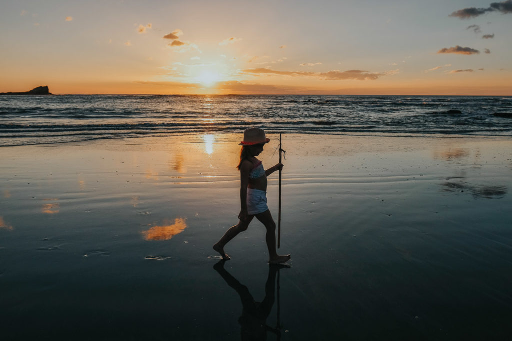 girl on beach at playa pelada silohuette at sunset nosara costa rica wedding photographer