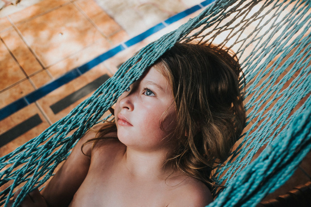 girls face in hammock at tico adventure lodge playa samara costa rica