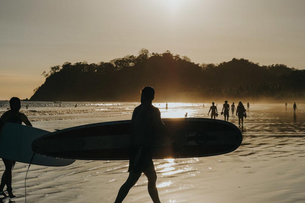 sillhouette of surfers at sunset costa rica playa samara beach