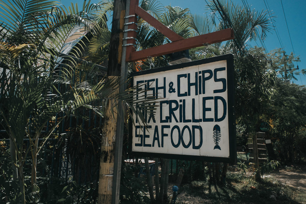food menu restaurant sign at playa samara costa rica tropical palm trees