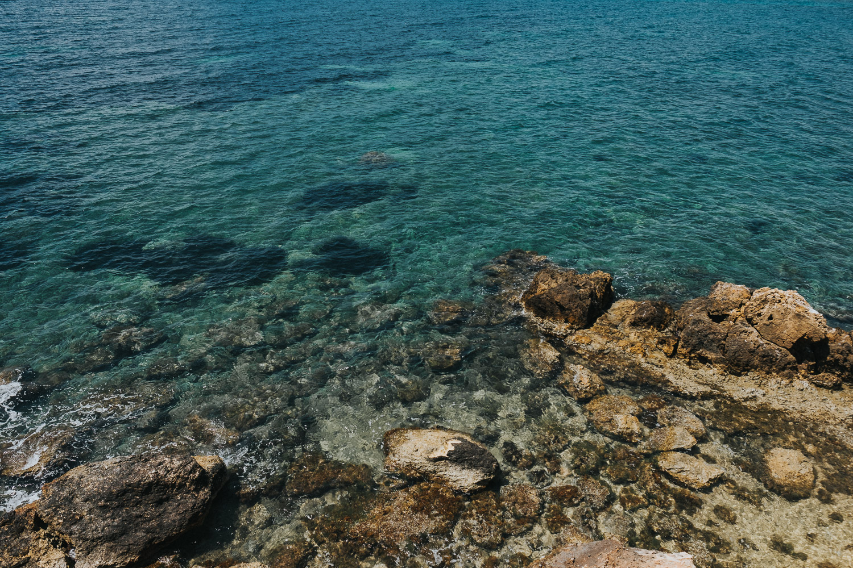 destination wedding photographer prices blue sea close up in ibiza