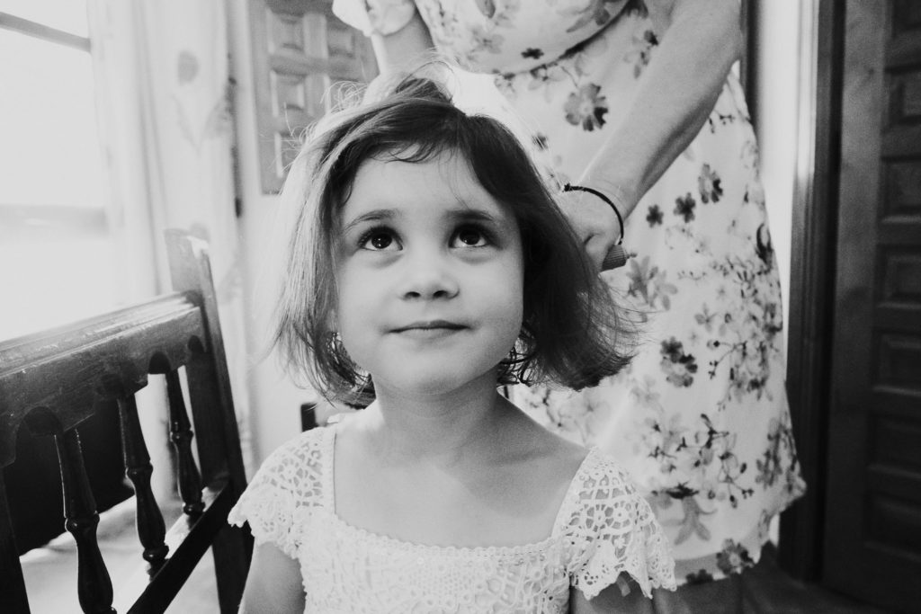 small girl having hair blow dried black and white jerez wedding photographer