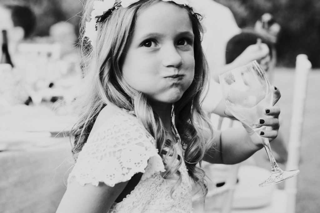 little girl at wedding big sip mouth full wine glass black and white jerez wedding photographer