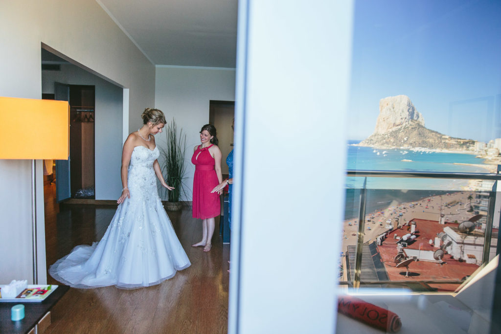 SOL Y MAR CALPE COSTA BLANCA WEDDING PHOTOGRAPHER BRIDE IN WEDDING DRESS WITH CALPE ROCK