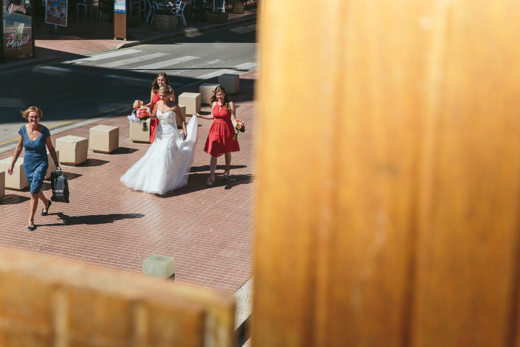 BRIDE AND BRIDESMAIDS WALKING SOL Y MAR CALPE COSTA BLANCA WEDDING PHOTOGRAPHER