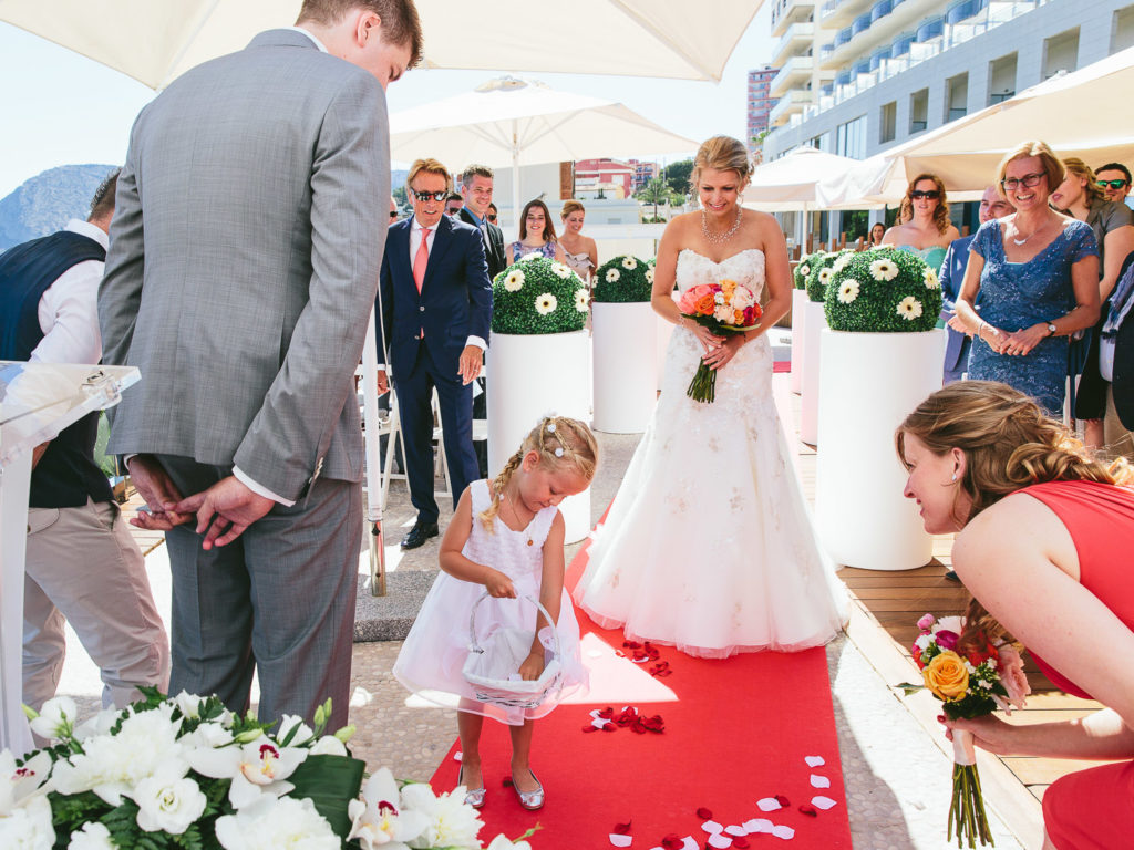 SOL Y MAR CALPE COSTA BLANCA WEDDING PHOTOGRAPHER FLOWER GIRL WITH PETALS AND BRIDE AND GROOM