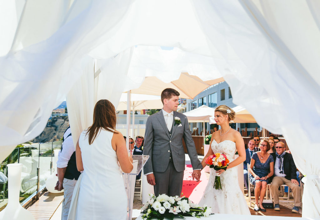 SOL Y MAR CALPE COSTA BLANCA WEDDING PHOTOGRAPHER BRIDE AND GROOM GREETING AT CEREMONY