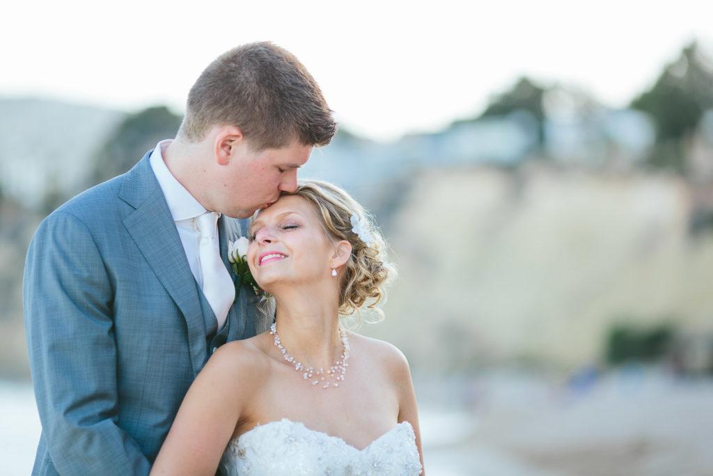SOL Y MAR CALPE COSTA BLANCA WEDDING PHOTOGRAPHER BRIDE AND GROOM KISSING ON BEACH