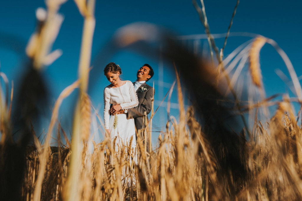 kent wedding photographer bride and groom in wheat field in summer blue sky in kent