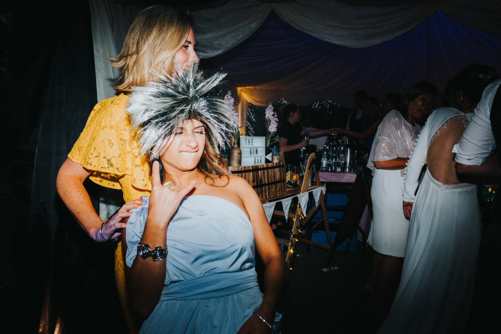 bridesmaid in wig on dancefloor kent wedding photographer
