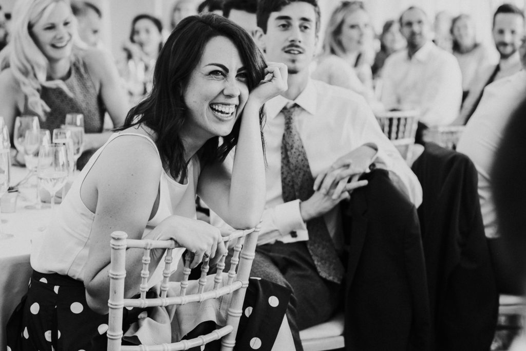 kent wedding photographer black and white photo of guest laughing