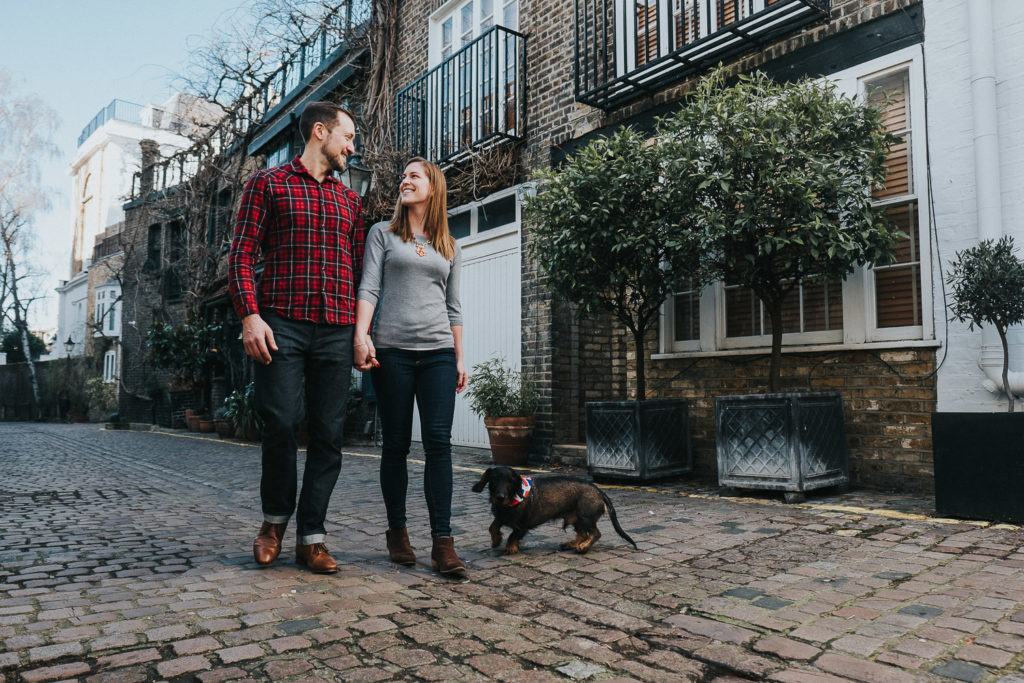 COUPLE WALKING ON MEWS STREET IN LONDON WITH SAUSAGE DOG SOUTH KENSINGTON PHOTOGRAPHER