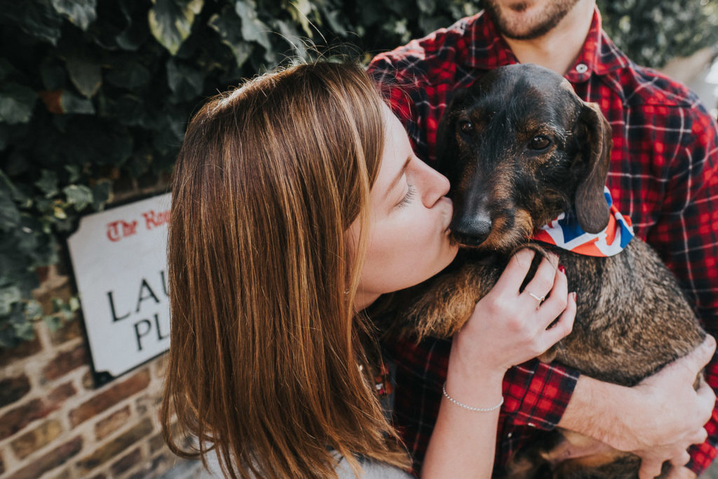 WOMAN KISSING DASCHUND SOUTH KENSINGTON PHOTOGRAPHER